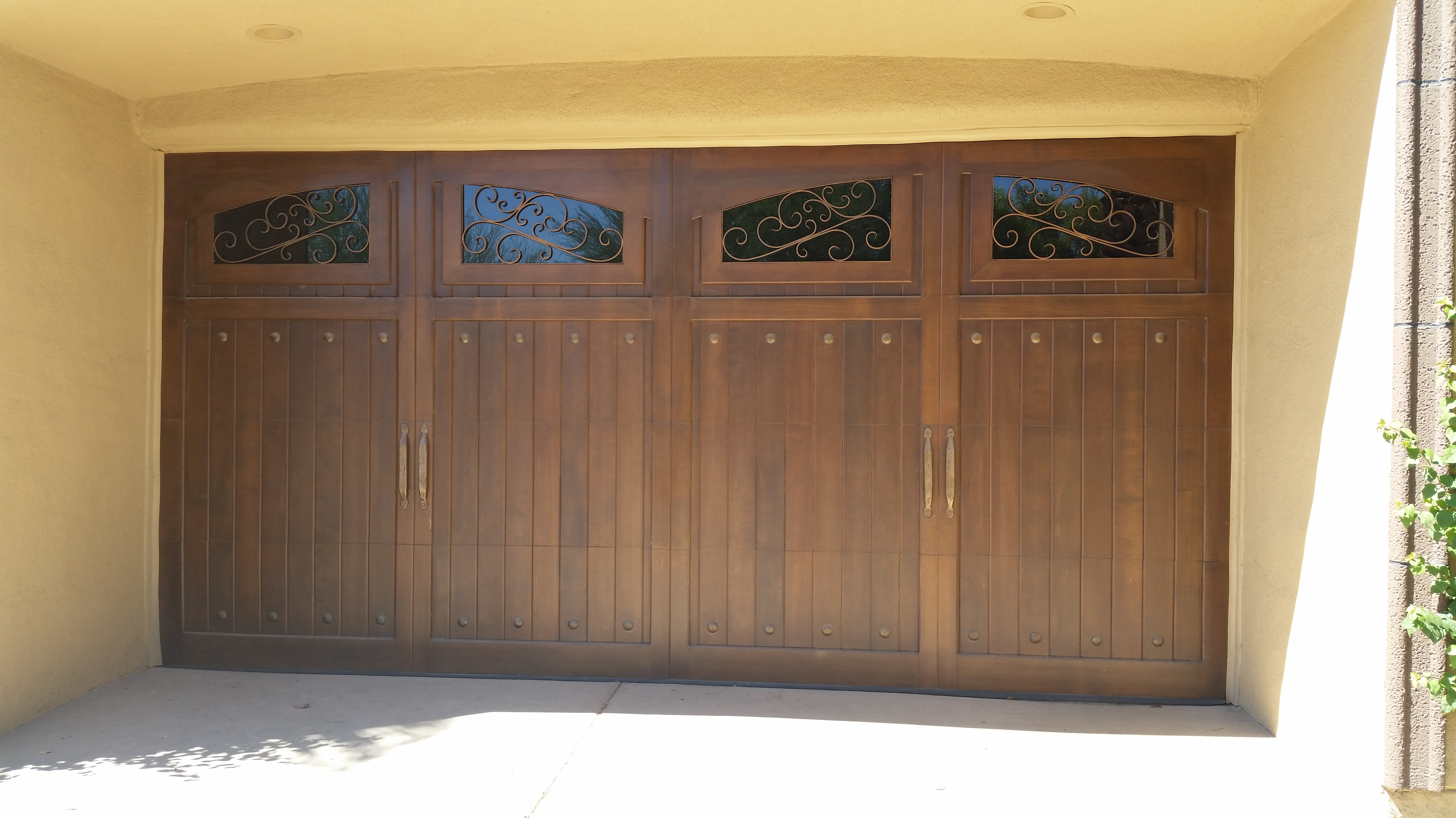 2988 #9F7B2C Double Arch Design With Windows And Decorative Hardware Garage Doors  wallpaper Double Garage Doors With Windows 38455312